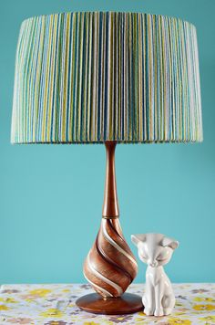 Light up a vintage lamp by stringing yarn around the lampshade for a new, retro look! #DIY