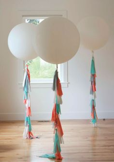 How to make balloon fringe tassels. So fun and festive. Balloons for party decoration . Love these huge round balloons.