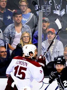 JGL with Channing getting rowdy at a hockey game