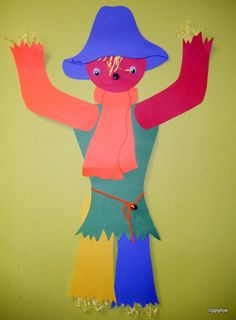 Kid sized fall scarecrow! Tell them why they are used and show the other methods for detouring birds around plants
