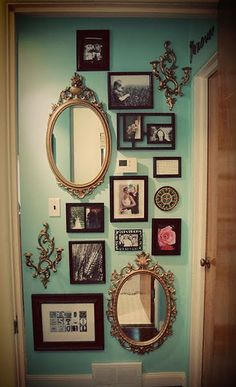 Eclectic mix of photography and mirrors - love for the stairs or walls in the living room. Such a good idea.