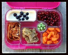 My 8-year-old packed this one all by herself by using the food pics/labels in this new lunch box (covered up by her food) that showed her what should go in each compartment. So for dairy she packed yogurt, for fruit she packed pomegranate seeds, for vegetables she packed carrots, for grains she made herself some whole-wheat garlic toast, for protein she packed some leftover spaghetti with meat, and in the little extra unlabeled spot she put frozen peas.