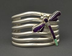 Cuff | Michael Na Na Ping Garcia (Yaqui).  Sterling silver with sugilite and gaspeite dragon