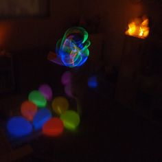 Moon balloons.......Put glow sticks inside and turn out the lights. Fun!!!