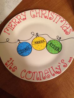 Our family Christmas plate! :) Painted with oil based sharpie paint pens and baked at 350 for 30 minutes.