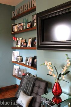 Have an awkward inset and don't know what to do with it? How about floating shelves to display your family photos.These shelves are only 5 inches deep, but they are perfect for a photo wall!