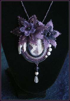 Violet and white ametyst floral beadwork pendant with natural pearls. €80.00, via Etsy.