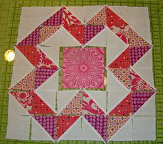 This block has very good instructions on how to sew it.....DSC04733 by sewcraftyjess, via Flickr uses HST
