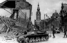 French tanks pass through a bombarded French town on their way to the front line in France, on May 25, 1940. (AP Photo) . The tank, with his  very short barrell  small caliber cannon and the peculiar small cupola on the turret, could be a Renault Char léger Modèle 1935 R. #worldwar2 #tanks