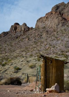 an outhouse sits in the ghost town outside of nelson nevada