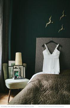 i really love this dark green, grey, gold bedroom.