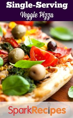 Spinach-Feta Personal Pizza. AWESOME! I used a garlic and herb feta cheese and the flavors were fantastic. So simple and delicious!| via @SparkPeople #pizza #healthy #smartswaps #dinner #recipe #singleserving