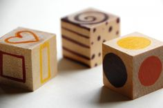 Art Dice: Shapes, lines and/or patterns on 3 wooden blocks--roll and draw whatever they show. Good to do yourself in front of them till they get it and are inspired to try on their own.
