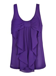 Purple chiffon top with bow on the front. With white skinny jeans....What a cute outfit...not to mention a cute Sigma outfit :)