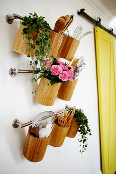 Vertical kitchen storage made from towel bars!! (via abeautifulmess.com)