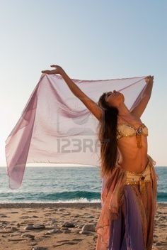 Sexy oriental dancer spreading her arms with a headscarf Stock Photo