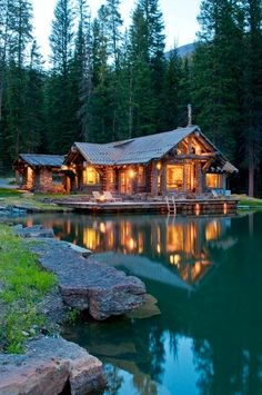 I totally love this house! I love how it is lite up and it looks so pretty especially with the lake and the lake it makes a beautiful background