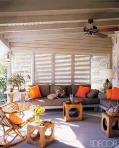 For the veranda of his own vacation home in the Bahamas decorator Tom Scheerer accented custom-made banquettes with Indonesian sarongs alons...