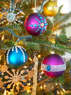 All you need to create these beautiful jeweled ornaments are colored ball ornaments in different sizes and self-adhesive jewels. #christmas #holiday #crafts