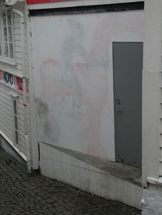 long live street art! a piece by David Choe and DVS1 whitewashed over but coming back to life