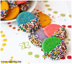 Colorful and sprinkly chocolate dipped sugar cookies