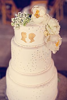 beautiful vintage wedding cake with gold silhouette
