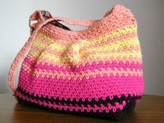 Crocheted hobo bag in brown pink yellow and peach.