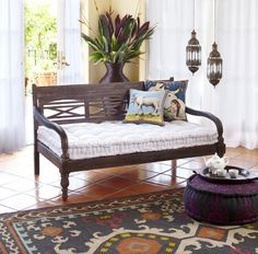 I'm still pissed I didn't buy this oversized Indonesian bench when I had the chance. World Market, 2009.