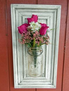 mason jars and old cabinet door panels..I would put in more modern flowers or grasses but its a great idea!