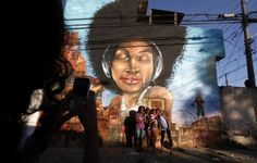 "The Goddess Of Vila Flavia    Photo: Nacho Doce/Reuters    in Sao Paulo, Brazil - by OPNI ""Unidentified Graffiti Artists"""