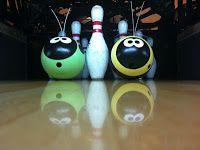 Salvaged bowling balls made into garden art.