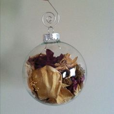 Christmas ornament filled with the dried flowers from any event