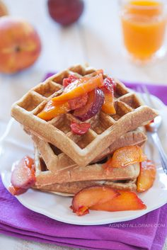 Fluffy gluten-free Paleo waffles with homemade stone fruits reduction syrup
