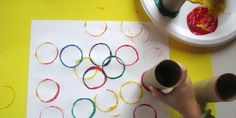 Olympics Theme...Painting Olympic rings with toilet paper rolls.