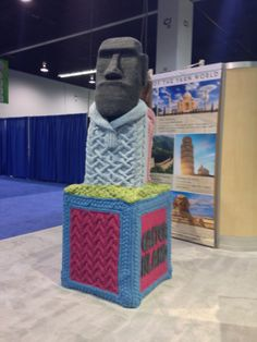 HUGE Easter Island heads made with Lion Brand Yarn! The theme in this booth was the 7 Wonders of the World.