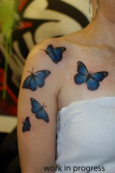 Blue butterfly tattoo on shoulder