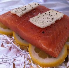 Salmon in a Bag - Tin foil, lemon, salmon, butter, salt and pepper - Wrap it up tightly and bake for 25 minutes at 300.