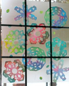 Make beautiful rainbow snowflake window art using just a few items. Even toddlers will have fun making the colored paper to use!  Perfect indoor activity for cold days.