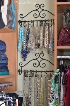 Organizing Jewelry - towel rack from hobby lobby shower hooks from Walmart! Could also use for scarves and belts!