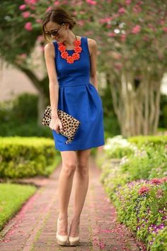 blue dress, coral necklace, nude pumps and animal print clutch
