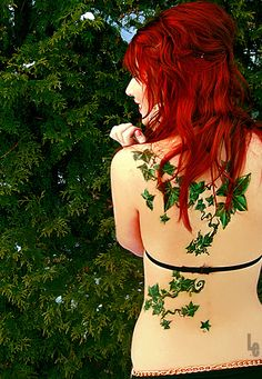Gorgeous red hair and green ivy tattoo