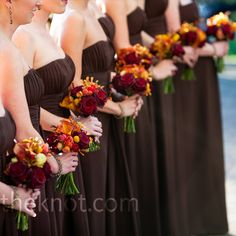 The exposed stems of their burgundy bouquets added a pop of green to the girls' looks.