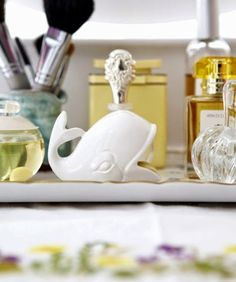Small nautical decorative touches..., cute whale soap dish. Featured on CC: http://www.completely-coastal.com/2014/07/blue-and-white-nautical-cottage.html