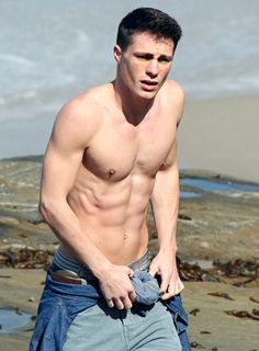 Colton Haynes flaunting his chiseled abs in Malibu in April 2012.