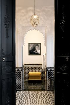 A gorgeous Silver Moroccan pendant in a Moroccan hotel. the doors, moroccan style, hotel, morocco, bathroom, mosaic tiles, gray wall, islamic art, decorative doors