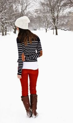 Adorable winter fashion striped sweater, red jeans & boots