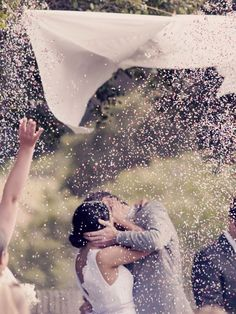 During your first kiss, have your maid of honor and best man pull strings to release a shower of confetti! #SomethingSparkling