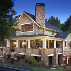 wrap around porch and stone work. gorgeous.