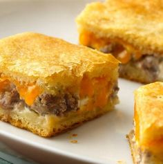 Recipe For Sausage and Cheese Crescent Squares - Sausage and two kinds of cheese turn crescent dough into a rich and tasty breakfast or appetizer.