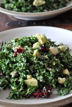 Kale and Quinoa Salad    Ingredients:    8 cups finely diced kale  3 tablespoons fresh lemon juice  1-2 tablespoons seasoned rice vinegar  2 tablespoons olive oil  pinch salt  1-1/2 cups cooked & cooled quinoa  3 tablespoons chopped macadamia nuts  3 tablespoons dried cranberries  1/2 avocado, diced